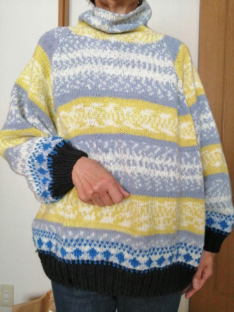 編み込み模様のセーター